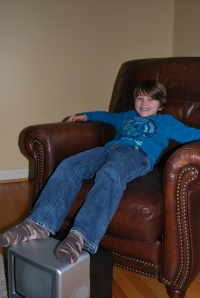 Brycen was tired from all of his activities and decided to take a break.  Grandpa's gift made a perfect foot stool!