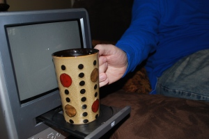 Jim found it to be ther perfect cup holder.  No coasters needed around here!